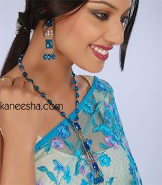 Turquoise Silver Fringe Necklace Set Wickedly gorgeous turquoise beads mix with genuine silver tone chains, spacers and dangles set in square turquoise stones. Matching long earrings. Length of earrings approx. 5.5 inches.  #UniqueFashionJewelry #BuyTraditionalJewellery