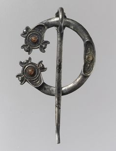 Silver and Amber Open Ring Brooch, Pictish or Irish, c. early 800s. Found near Galway, Ireland