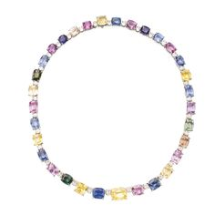 Platinum, Multi-Colored Sapphire and Diamond Necklace The flexible necklace set with alternating pink, purple, blue, green, yellow and orange sapphires, accented by oval-shaped diamonds, length 18 inches.