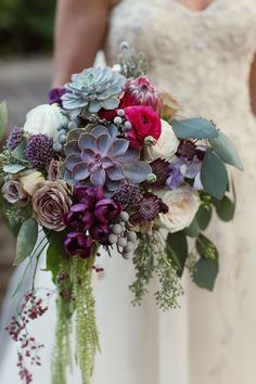 TULIP, ECHEVERIA, SUCCULENT AND MINK PROTEA BOUQUET: The oh-so-trendy succulent makes a striking appearance in this wedding bouquet, surrounded by jewel tones.  Via Strictly Weddings and Alison Conklin Photography