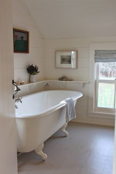 Sheila Narusawa overhauled this cottage bathroom with a wraparound open shelf, a white clawfoot tub, and painted wood floors. See the rest of the house in A Cottage Reborn in Coastal Maine.White Bathrooms from the Remodelista Architect/Designer Directory Beautiful Bathrooms, My New Room, Bathroom Inspiration, New Homes, Sweet Home, House Ideas, House Design, Floor Design, Tile Design