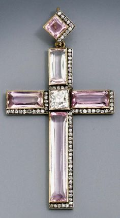 A Belle Epoque jewelled gold-mounted pendant cross, by Fabergé, Odessa, 1908-1917. With the workmaster's mark of N. Chistiakov and scratched inventory number. The old-brilliant-cut diamond centre with rectangular-cut pink topaz arms bordered by old-brilliant-cut diamonds on the right and lower sides, with similar pendant loop, marked on loop and ring. #Faberge #BelleÉpoque #pendant