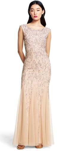Glimmering beads and sequins shine across this cap sleeve mermaid gown, flared by wispy godets.