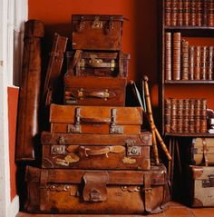 Stacked beautiful, old, vintage leather suitcases.