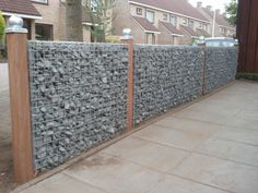 Gabion fencing No instructions but this looks like a great project to use up tons of rock from your property or the neighbours. Great privacy & should reduce outside street noise.