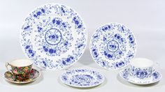 """Lot 440: Tiffany & Co. """"Alpine Blue"""" Partial China Service; Fifty-eight items including (11) dinner plates, (12) salad plates, (11) bread plates, (9) coffee cups, (12) saucers, a round serving bowl, an oval platter, a creamer and a sugar; together with a Royal Winton """"Beeston"""" partial set including (6) dessert plates and (6) cups with saucers"""