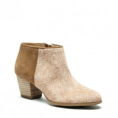 A must-own tan ankle bootie crafted from luxurious soft suede & haircalf