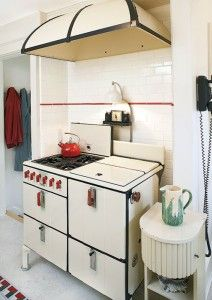 A vintage stove occupies a tiled alcove.