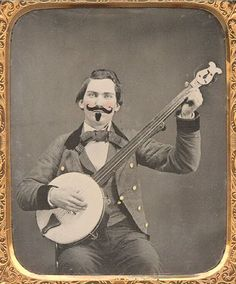 "ca. 1860, [ambrotype portrait of a gentleman strumming a banjo, with applied hand-coloring and a finely etched false ""imperial"" ..."
