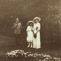 "Tsar Nicholas II of Russia, Grand Duchesses Anastasia and Olga Nikolaevna Romanova of Russia in 1913. ""AL"""