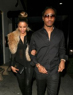 Ciara and Future all black walking- Love Ciara's look with caramel-colored fur stole...