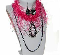 Get this Pink Feather Zebra Print Choker Set ($18.99) only available at ismchick.com. Free shipping is available.