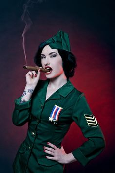 Portrait of a Pinup Burlesque Diva performing in military dress, smoking cigar. Military Costumes, Military Dresses, Sexy Costumes For Women, Unique Costumes, Costume Ideas, Female Hero, Female Soldier, Top 10 Halloween Costumes, Warrior Girl