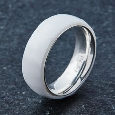 Ceramic Ring Design Notes 8MM Width High Polished Shine Fine Silver Interior Smooth Comfort Fit Cobalt Free (No Allergy Reactions) Ceramic Exterior: The EMBR ce