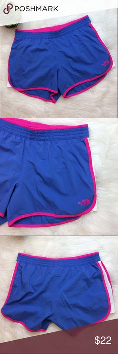 The North Face Blue and Pink Running Shorts The North Face Periwinkle blue running shorts with neon pink trim. White mesh side panels and built in underwear. Size Medium. The North Face Shorts