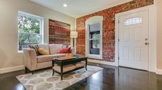 Traditional Living Room with Carlisle Stone Hearth Wide Plank Floor, interior brick, Hardwood floors, High ceiling, Carpet