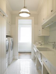 Love this laundry room especially because of the white subway tiled floor and classic farmhouse sink