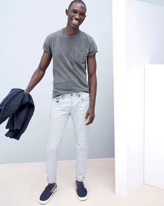 APR '15 Style Guide: J.Crew men's garment-dyed tee in highline grey, 484 jeans in indigo extraction wash, and Vans for J.Crew classic slip-on in two-tone denim.