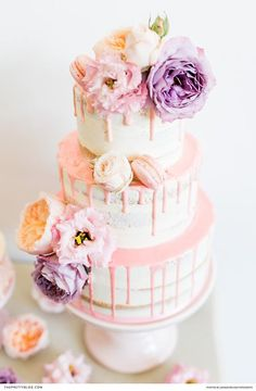 Three tiered pastel wedding naked cake with pink dripping detailing and pastel fresh flowers