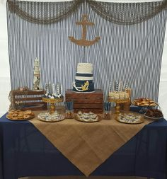 Nautical baby shower theme dessert table and backdrop. Anchor cake. Navy blue and burlap nautical theme.