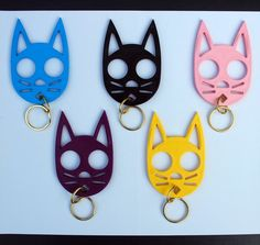 Kitty Keychain Self-Defense Device--put your index and middle finger through the eyes and you can protect yourself.  FOR PROTECTION ONLY