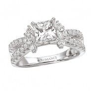 Princess cut Halo complimented by exquisite diamonds on each side