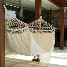 This Brazilian hammock is woven of cotton by the talented Hammock Artisans of Ceara. They crochet the floral fringes by hand and include sturdy eucalyptus spreader bars for comfort.