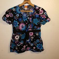 NrG scrub top Beautiful floral scrub top. NrG by Barco. In excellent condition. NrG Other