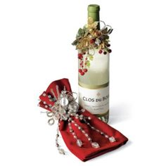 Wine Bottle Jewelry adds an unexpected touch of panache to wine bottles, gift wrapping, or holiday table settings.
