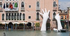 """A pair of god-like hands emerged from the canals of Venice, Italy. """"Support"""""""