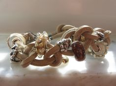 Beige Leather in a very creative way! Such great inspiring ideas on Trollbeads Gallery Forum!