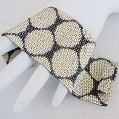 """Punchinella or Where Have All the Sequins Gone Peyote Cuff Bracelet (2444). his bracelet is woven in peyote stitch using Japanese delica beads in gunmetal and galvanized silver. It is 2"""" wide and will be made to 6.5"""" long"""