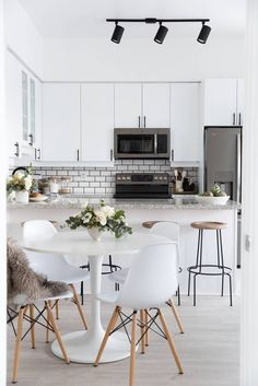 the chicest all-white kitchen / dining room.