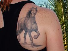 Trotting realistic  horse tattoo.