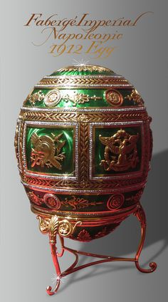 Peter Carl Fabergé IMPERIAL NAPOLEONIC EGG. Workmaster: Henrik Emanuel Wigström (Finnish). Gold, guilloché enamel, rose cut diamonds, ivory, silk velvet. Gift from Russian Czar Nicholas II to his mother, Maria, Easter 1912. Commemorating the centenary of the Russian victory over Napoleon. On loan from The Matilda Geddings Gray Foundation Collection to The Met Museum of Art, NYC. Original Orlov Photo, 2015. FRONT VIEW WITH GOLD STAND.