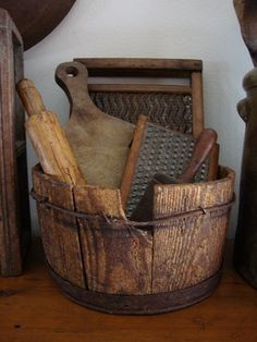 Old wooden bucket, vintage kitchen tools, cutting boards for rustic cottage kitchen. Primitive Laundry Rooms, Primitive Homes, Primitive Kitchen, Primitive Antiques, Country Primitive, Primitive Decor, Primitive Bedroom, Rustic Kitchen, Prim Decor
