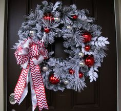 Decorating Ideas. Cool Christmas Winter Wreath with Lovely Handmade Double Ribbon Chevron Bow, and Cool Eye-Catching Red and Silver Christmas Ornaments. Modern Unique Wreaths to Dress Up Beautifully Outdoor and Indoor Areas for Festive Christmas Holiday