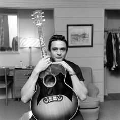 Johnny Cash. I have this guitar tattooed on my arm. Beautiful <3