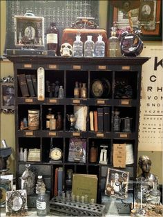Tim Holtz 2013 LABORATORIE line When both parents were chemists and their labs were filled with beakers flasks Bunsen burners and vial labels written in tiny cursive script how could I not put this on my Wishlist? Diy Tableau, Apothecary Cabinet, Apothecary Bathroom, Apothecary Bottles, Bunsen Burner, Vitrine Miniature, Miniature Houses, Halloween Apothecary, Cabinet Of Curiosities