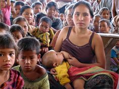 A collection of pictures of mothers around the world breastfeeding their babies
