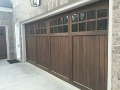 Custom wood garage door with Windows.