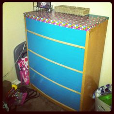 So I bought this dresser for about $15-$20 at a moving sale. It had scratches, dings, and some things written in permanent marker on the top. I contemplated stripping it and painting or staining it. Then I thought about covering it in wallpaper to save dragging it out and stripping it. And then it hit me! Duct tape! I bought two rolls which cost me a whopping $8 and covered it in 15 minutes. Best DIY I've ever come up with.