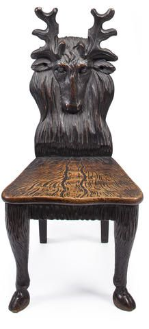 A Black Forest style carved oak hall chair first half 20th century