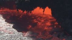 Close view to an eruption in a small cave of the Erta Ale volcano lava lake - HD stock video clip