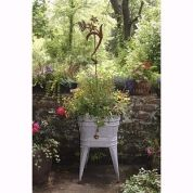 """Creating a garden in a rustic wheel barrow or cast-off wagon multiplies your options without increasing your labor: Wheel your portable Eden out to the patio or deck when you're entertaining outdoors, or """"park"""" it in any corner of the yard that would benefit from an instant touch of greenery or whimsy."""