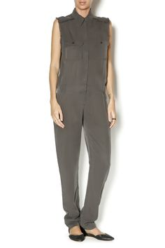 Sleeveless jumpsuit featuring a button down front, front pockets and frayed edges. Perfect for a dose of subdued, monochromatic cool