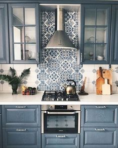 kitchen with blue and white tile feature wall