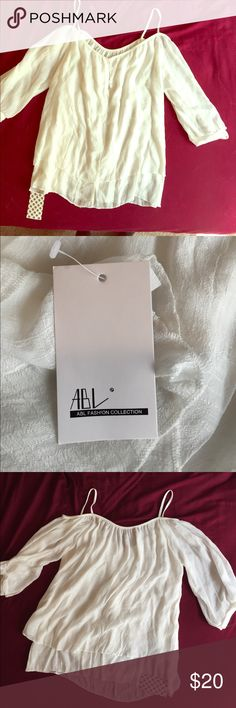 White women's top ABL fashion collection white women's top. Shoulder cut out. Size large. Never worn. Tags still on ABL Fashion Collection Tops Blouses