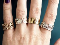 North Carolina-based goldsmith Ola Shekhtman designs these fun skyline rings that wrap entire cityscapes around your finger.