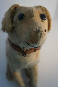 Straw stuffed mohair dog with squeaker antique